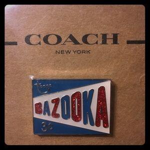 "NWT Coach ""Bazooka"" pin."
